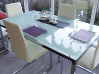 Glass and chrome dining table (no chairs)