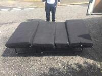Camper bed pulls out as seat