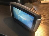 TomTom Rider 400 Premium with charging cradle.