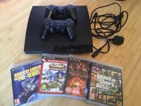 Ps3 with 2 controllers and 4 games