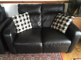 Black leather two seater sofa and 2x arm chairs