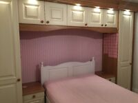 Fitted wardrobes with bedside cabinets and fly shelf with lights