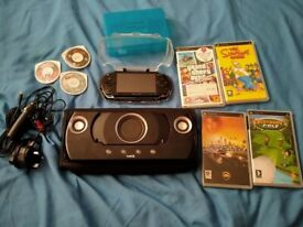 Psp with game's and logic 3 stand/speaker's
