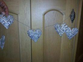 Three garlands of small hearts