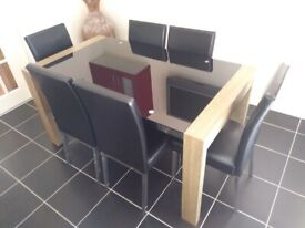 Modern Black Glass Dining Table and 6 Padded Chairs