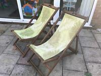 Two outdoor wooden deckchairs