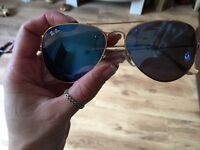 ray bans flash lens aviator sunglasses blue and silver pair
