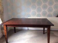NEXT dark wood dining room table.