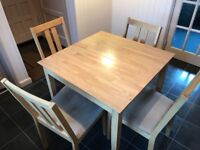 Extending kitchen table and four chairs. Very good condition all round