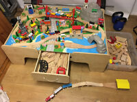Play table with wooden train set and toys including some thomas tank engine large pieces....