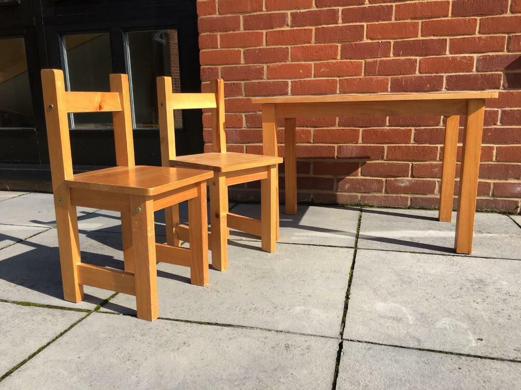 Child's pine table and two chairs