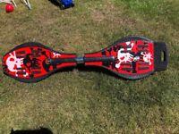 Ripstik/wave board. Red skull design. Uni-sex