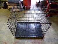 Fully folding metal dog cage.
