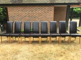 8 matching faux leather dining chairs.Some more worn than others but very comfy