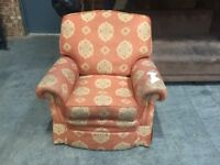 Orange single armchair with a design