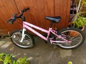 Girls pink bike hardly used