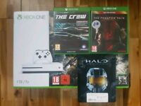 Boxed white Xbox One 1TB in excellent condition comes with 3 games and 2 year warranty