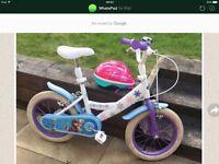 Girls Frozen bike and Barbie helmet