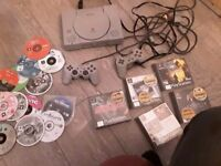 PS 1 with 2 x controllers , and games