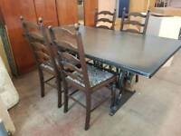 Large oak table and four patterned chairs