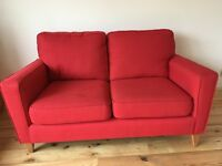 Almost new 2 seater red Sofa from Harveys
