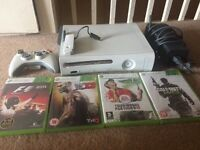 Xbox 360 + games + wireless adapter + wireless controller