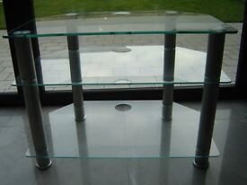 Glass TV stand in perfect condition.