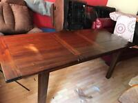 Solid oak stained dark extending dining table with 6 high back chairs
