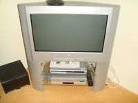 """Sony Triniton 28"""" TV with Bush DVD Player complte with stand + remote conrols and manuals."""