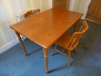 Pine dining table and 2 pine chairs
