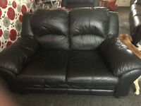 Black 3 seater and 2 seater sofas in good condition