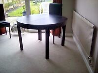 dining table, extendable x 2 easy to fold away. Light wood or black/brown ikea. lovely top surface.