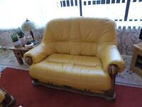 TWO SEATER LEATHER AND WOOD SOFA