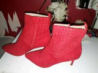 Bright red studded heeled boots