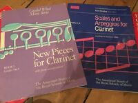 Clarinet stand and collection of music books