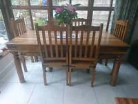 Dark wood dining table and six chairs and coffee table