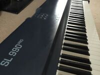 Studiologic SL-990 PRO 88-key weighted midi controller in very good condition.