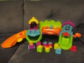 FISHER PRICE STACK & SURPRISE BLOCKS MUSICAL SILLYTOWN