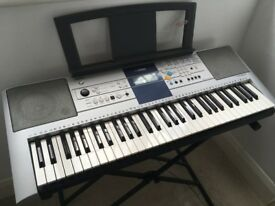 Yamaha PSR-E323 keyboard and stand