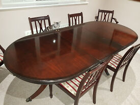 Extendable Mahogany Veneer Dining Table with 4 chairs and 2 Carver