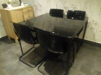 Black glass Table 1.1m sqaure with four black chairs