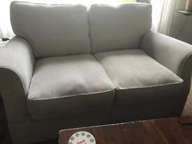2 Seater Sofa. With pouffe with storage.