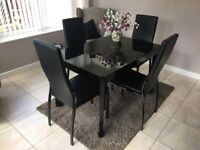 Glass-topped extending table and 4 chairs