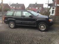 Jeep Grand Cherokee 4l petrol, LPG conversion auto black