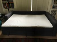 IKEA corner sofa-bed with storage and mattress topper