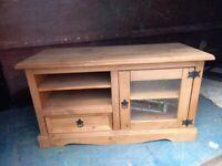 corona pine wood tv stand with glass door