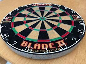 Winmau Blade II dartboard with Unicorn rubber surround