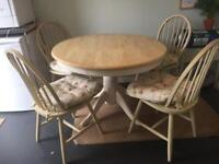 Table and 4 chairs plus seat cushions