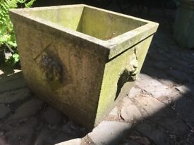 Two antique square planters with lion heads on all four sides