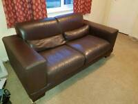 Leather sofas and pouffe